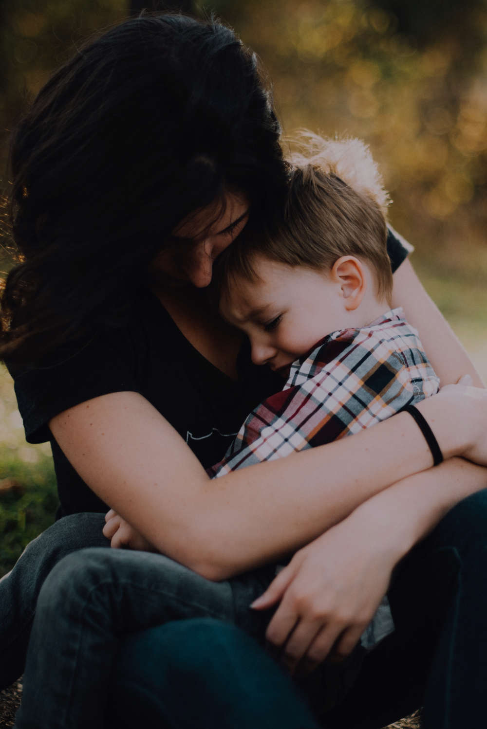 Woman Holding Her Crying Son