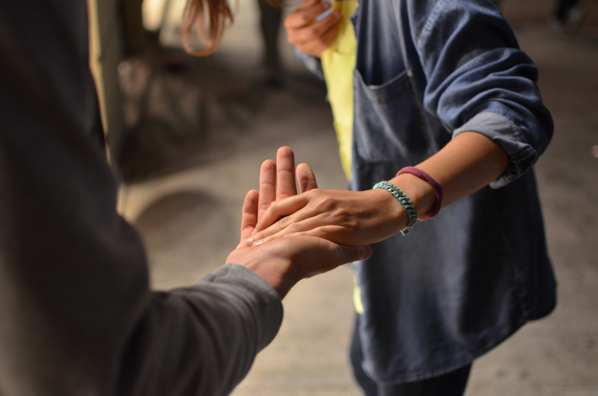 Woman Taking Taking a Man's Hand